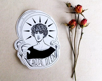 glossy art sticker with an inscription in Latin