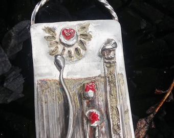 Pendant of silver with picturesque scene