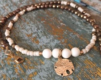 Gold and white, bracelet, beaded, bracelets, double bracelet, white bracelet, dollar charm, bracelet