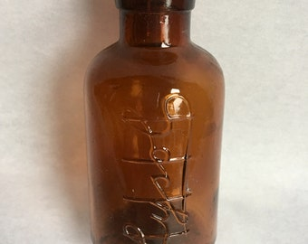 Vintage dark amber Lysol bottle
