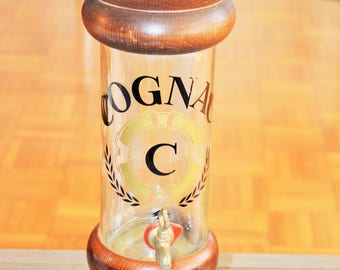 Bottle of Cognac vintage with tap