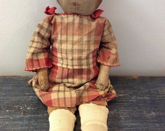 Antique cloth doll with drawn features