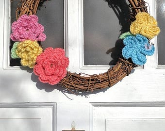 12 inch grapevine wreath with pastel crochet flowers