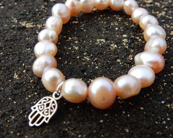 Mauve pink pearl stretchy bracelet with sterling silver hamsa hand