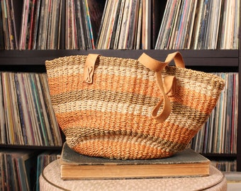 vintage sisal bag with leather handles . large woven market tote bag purse with muted peach stripes
