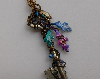 Wire Wrapped Key Pendant -- Faery Enchanted Oak Tree with Purple, Blue, Teal Leaves, Antique Brass Wire, Swarovski Crystals