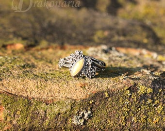 Twig ring - milky amber in silver, tiny, sculpted flowers, limited collection