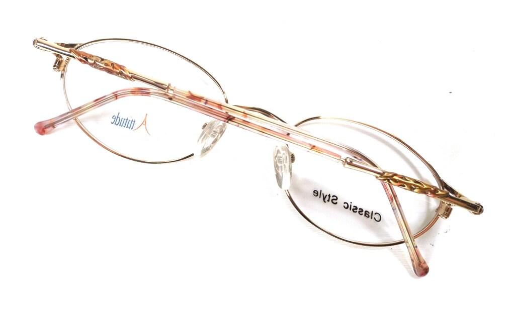 58e66261987 vintage 90s deadstock eyeglasses oval frames gold metal detailed fancy pink  blush orange plastic glitter translucent
