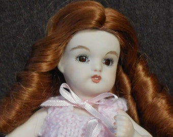 Porcelain 8 inch cabinet doll in pink knit dress - handmade by artist - Christmas Special