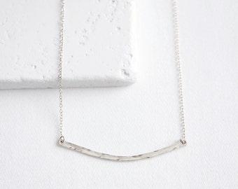Lightly Curved Bar Necklace   crescent bar necklace lightly hammered   sterling silver