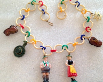Vintage Tyrol figurines, hat, shoes celluloid necklace
