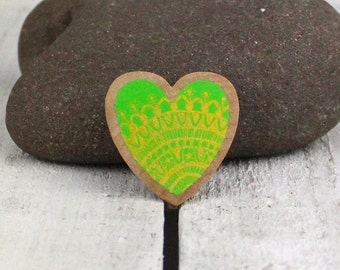 hand drawn wooden heart brooch pin in gold on green