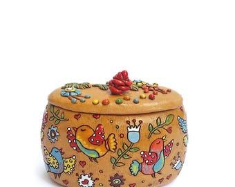Ceramic sweets box with happy birds of paradise