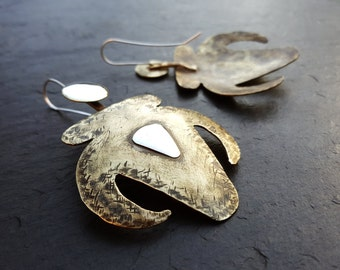 Shoulders of Stone - Brass and silver earings. From the Sand Snake and the Bull: A Gobekli Tepe myth of The Third Day