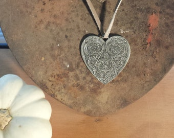 Boho heart pendant. Simple leather pendant with 80's heart focal point