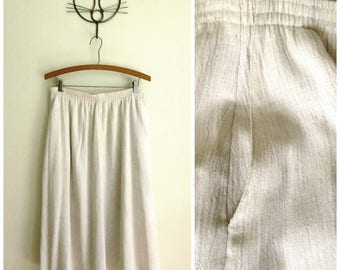 gauze skirt, neutral beige linen look with crinkled texture, gathered flared, 2 pockets, elastic waist, vintage 80s 90s medium 10