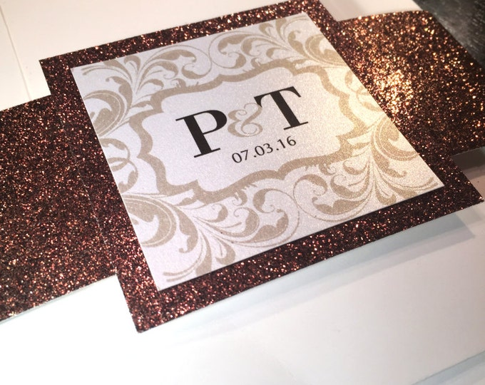Glitter belly bands for wedding invitation. Bronze glitter and champagne color theme. Elegant, fancy and chic medallion enclosure card.