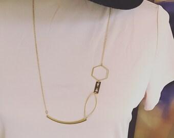 Geometric assymmetrical gold necklace