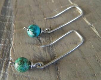 Earrings... Turquoise sterling silver earrings.