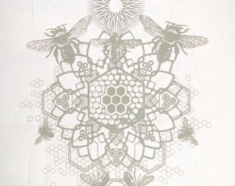 Bee Mandala in Brown on a Sand Khaki Softstyle 100% Cotton Tee