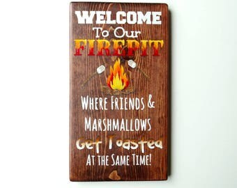 Welcome to our firepit where friends and marshmallows get toasted 13 inch tall solid wood sign hand painted wall decor