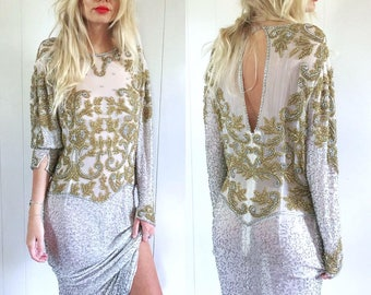 Vintage Stunning gold and silver heavy beaded gown.