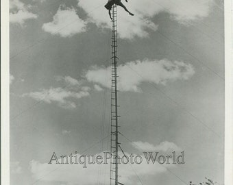 Amazing aerial high wire circus act stunt acrobat performer vintage photo