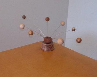 Recycled wood MCM inspired retro balancing kinetic wood sphere sculpture