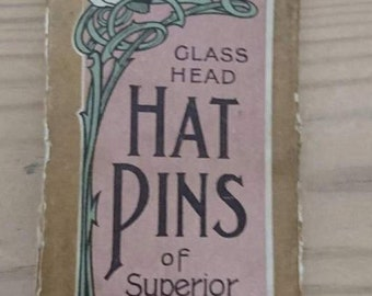 Three vintage hat pins with the original card