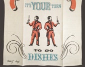 """Tammis Keefe Kitchen Towel, """"It's Your Turn To Do Dishes"""", Rust & Blue, Great Condition, Duel Pistols, Rare"""