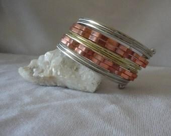 A Multi Silverplated Copper Bracelet Cuff***