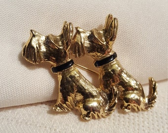 Scotty dog, brooch,two sitting.