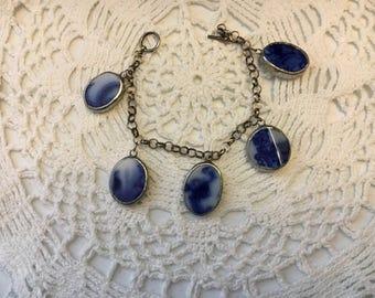 Flow Blue silver charm bracelet