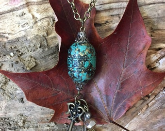 Pendant necklace with antique appearance