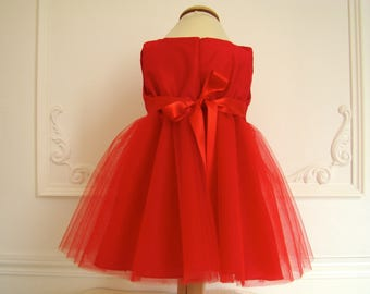 Ceremony in bright red silk and tulle baby dress