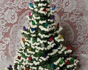 "18"" Tampa Bay Lighted Ceramic Christmas Tree Green - Flocked"