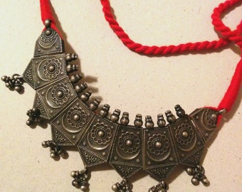 Indian silver necklace with red cord