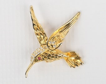"1980's CZ Pave Textured gold tone Hummingbird Brooch w Red Crystal Eye, Near MINT, 2-3/16"" L X 2"" H, Roll Over Clasp. No Maker Mark."
