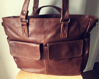 Perfect work or college handbag. Free Shipping Lots of compartments,flat handles,long straps makes a great leather shoulder travel tote bag.