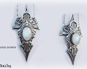Up and down. Moonstone occult pendant