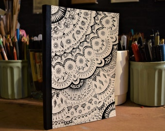 Notebook or Sketch-book.