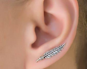 leaf ear climbers. curved ear climber. silver ear crawler. silver ear climber. ear crawler earrings. climbing earring . leaf ear crawler