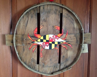Blue or red crab with Maryland flag on shell. Hand painted on recycled crab bushel lid.