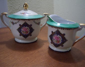 Noritake,pattern M,made in Japan,hand painted,matching creamer and sugar bowl,floral pattern,green rim,gold handles,dining and serving