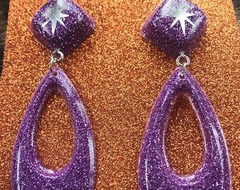 Purple atomic dangle glitter resin earrings