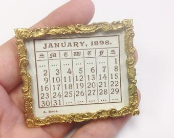 Antique, Victorian, Rococo, gilt metal picture frame desk calendar for 1898.