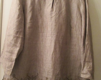 Beige linen size 1X ladies overblouse with beige embroidery on bottom front. 3/4 sleeve Round neck w single button close. Alexandra Bartlett