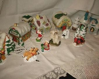 Village of Noma Christmas porcelain 14 pieces.