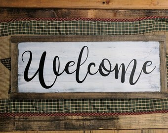 Welcome sign with wood border