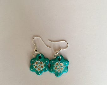 Handmade flower shaped blue earrings with pattern detail